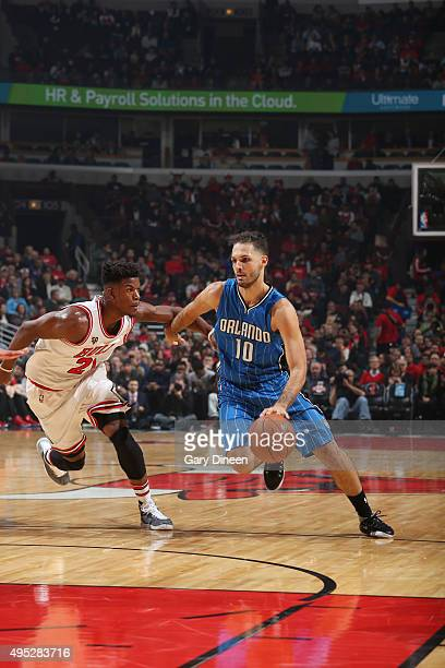 Evan Fournier of the Orlando Magic handles the ball against Jimmy Butler of the Chicago Bulls on November 1 2015 at the United Center in Chicago...