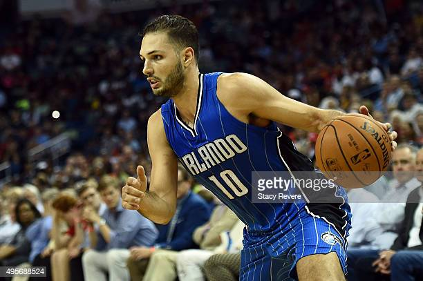 Evan Fournier of the Orlando Magic handles the ball during a game against the New Orleans Pelicans at the Smoothie King Center on November 3 2015 in...