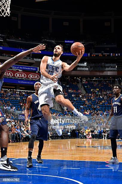 Evan Fournier of the Orlando Magic shoots the ball against the New Orleans Pelicans during a preseason game on October 21 2015 at Amway Center in...