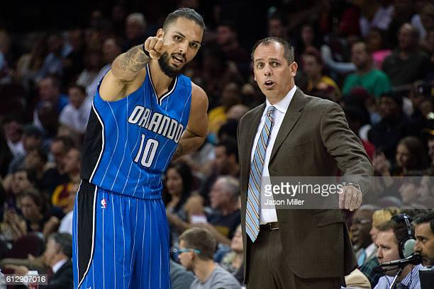Evan Fournier talks with head coach Frank Vogel of the Orlando Magic during the first half of a preseason game at Quicken Loans Arena on October 5...