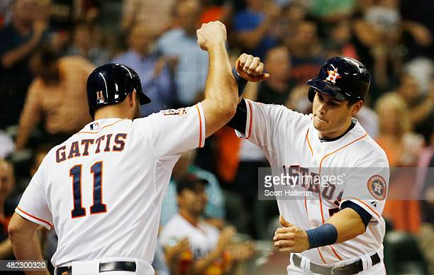Evan Gattis and Preston Tucker of the Houston Astros celebrate after Tucker hit a solo home run in the sixth inning against the Los Angeles Angels of...