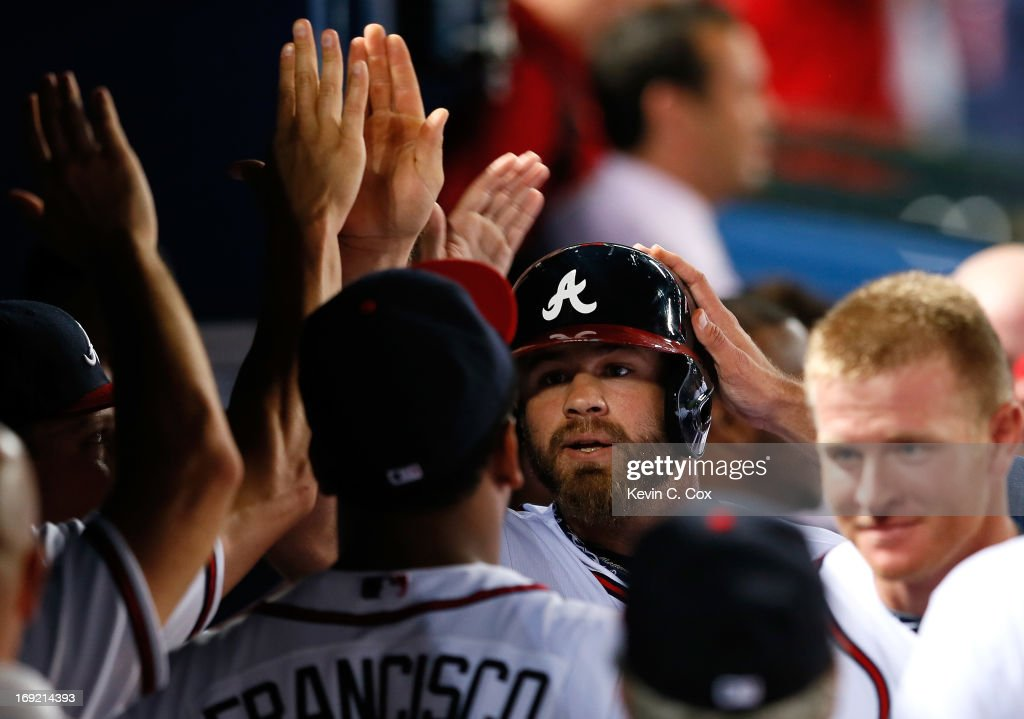<a gi-track='captionPersonalityLinkClicked' href=/galleries/search?phrase=Evan+Gattis&family=editorial&specificpeople=8977937 ng-click='$event.stopPropagation()'>Evan Gattis</a> #24 of the Atlanta Braves celebrates his solo homer in the bottom of the ninth that tied the game 4-4 against the Minnesota Twins at Turner Field on May 21, 2013 in Atlanta, Georgia.
