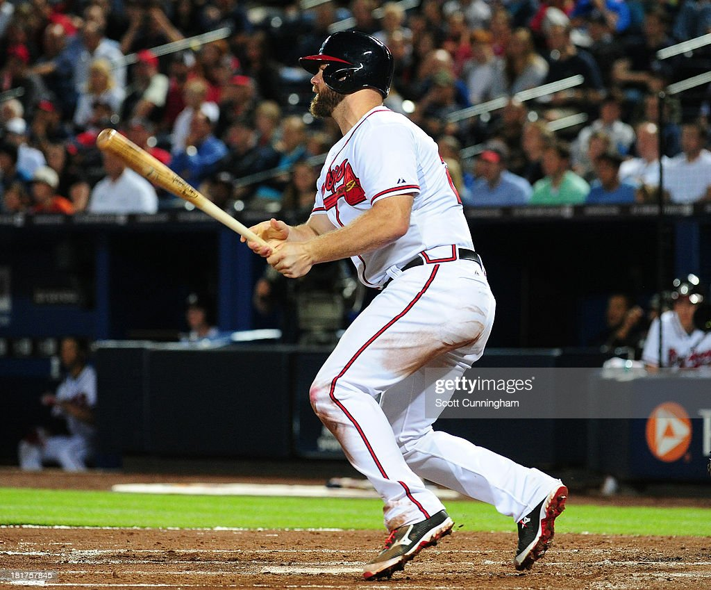 <a gi-track='captionPersonalityLinkClicked' href=/galleries/search?phrase=Evan+Gattis&family=editorial&specificpeople=8977937 ng-click='$event.stopPropagation()'>Evan Gattis</a> #24 of the Atlanta Braves hits a fourth inning run scoring a single against the Milwaukee Brewers at Turner Field on September 24, 2013 in Atlanta, Georgia.