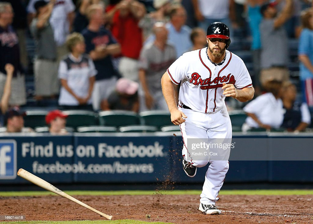 <a gi-track='captionPersonalityLinkClicked' href=/galleries/search?phrase=Evan+Gattis&family=editorial&specificpeople=8977937 ng-click='$event.stopPropagation()'>Evan Gattis</a> #24 of the Atlanta Braves hits a solo homer in the bottom of the ninth that tied the game 4-4 against the Minnesota Twins at Turner Field on May 21, 2013 in Atlanta, Georgia.