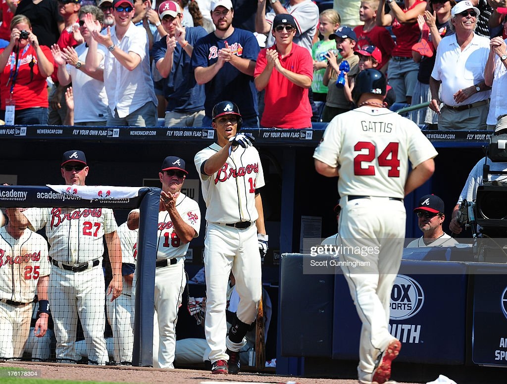 <a gi-track='captionPersonalityLinkClicked' href=/galleries/search?phrase=Evan+Gattis&family=editorial&specificpeople=8977937 ng-click='$event.stopPropagation()'>Evan Gattis</a> #24 of the Atlanta Braves is congratulated by <a gi-track='captionPersonalityLinkClicked' href=/galleries/search?phrase=Andrelton+Simmons&family=editorial&specificpeople=8978424 ng-click='$event.stopPropagation()'>Andrelton Simmons</a> #19 after scoring against the Miami Marlins at Turner Field on August 11, 2013 in Atlanta, Georgia.