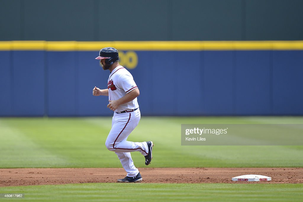 Evan Gattis #24 of the Atlanta Braves rounds the bases after hitting a two-run home run against the Philadelphia Phillies during the first inning at Turner Field on June 18, 2014 in Atlanta, Georgia.