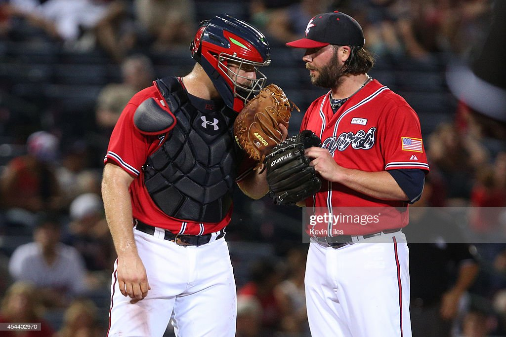 <a gi-track='captionPersonalityLinkClicked' href=/galleries/search?phrase=Evan+Gattis&family=editorial&specificpeople=8977937 ng-click='$event.stopPropagation()'>Evan Gattis</a> #24 of the Atlanta Braves (left) talks with Chasen Shreve #51 of the Atlanta Braves during the ninth inning at Turner Field on August 30, 2014 in Atlanta, Georgia.