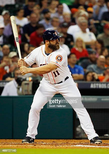 Evan Gattis of the Houston Astros at bat in the third inning of their game against the Oakland Athletics at Minute Maid Park on April 14 2015 in...