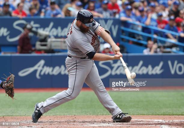 Evan Gattis of the Houston Astros bats in the fourth inning during MLB game action against the Toronto Blue Jays at Rogers Centre on July 9 2017 in...