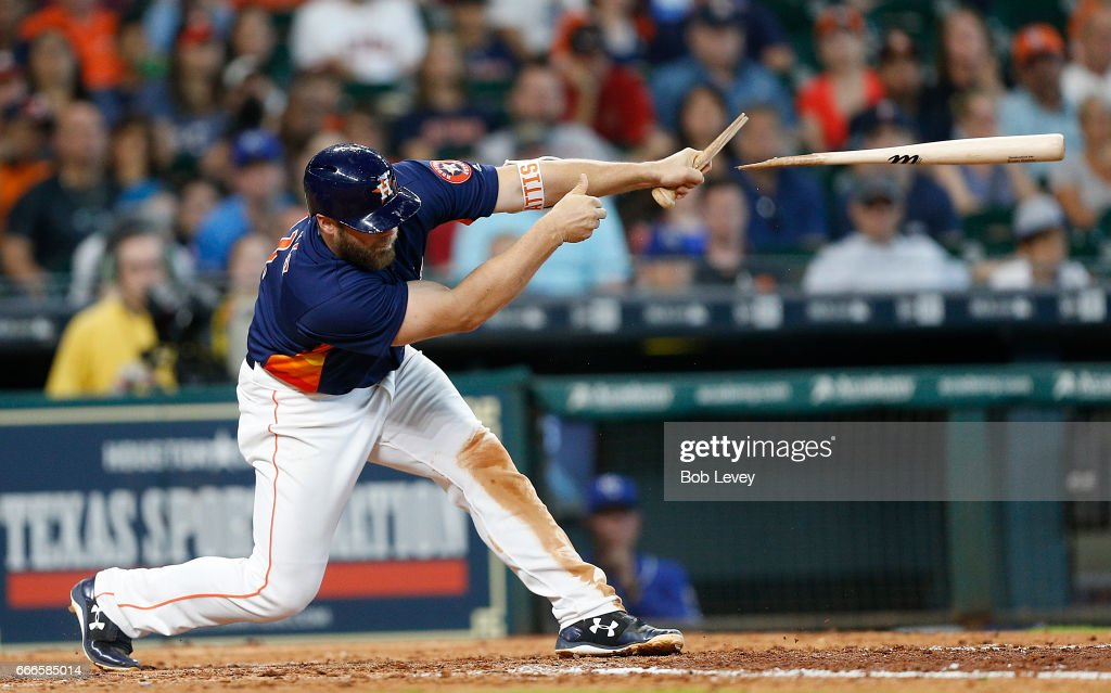 Evan Gattis #11 of the Houston Astros breaks his bat as he singles in the eighth inning against the Kansas City Royals at Minute Maid Park on April 9, 2017 in Houston, Texas.