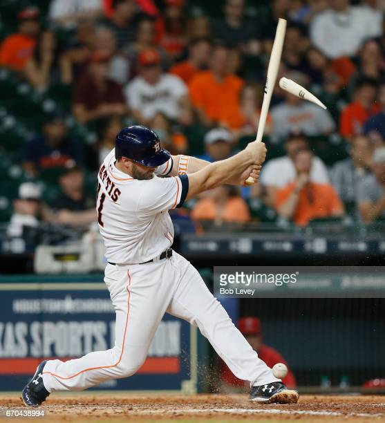 Evan Gattis of the Houston Astros breaks his bat on foul ball off his foot in the eighth inning against the Los Angeles Angels of Anaheim at Minute...