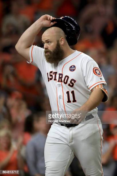 Evan Gattis of the Houston Astros celebrates after hitting a a solo home run against CC Sabathia of the New York Yankees during the fourth inning in...