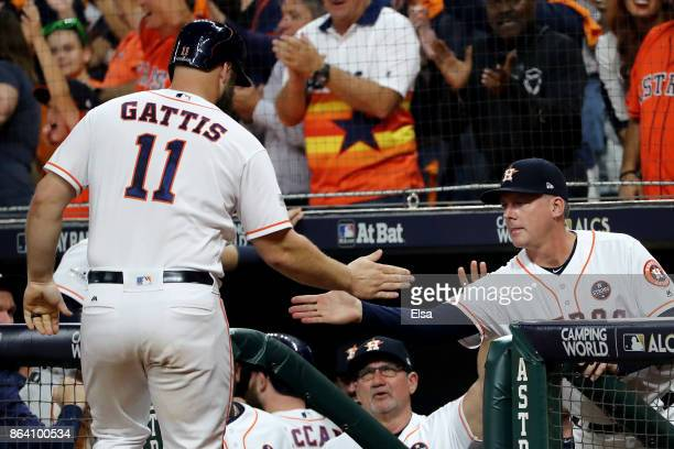 Evan Gattis of the Houston Astros celebrates after scoring off of a single hit by Jose Altuve against Luis Severino of the New York Yankees during...