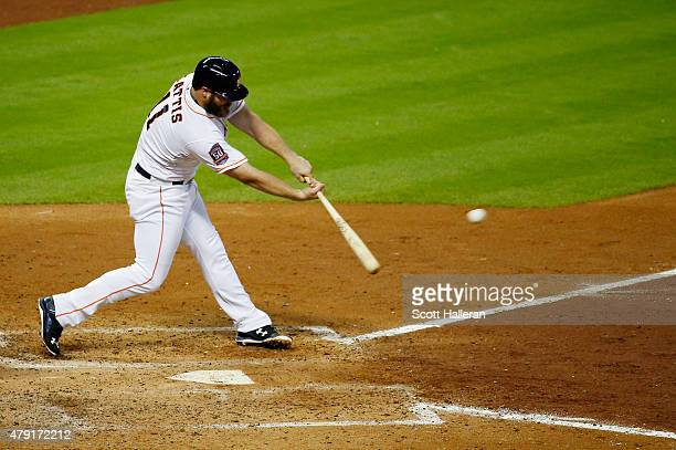 Evan Gattis of the Houston Astros drives in two runs in the fifth inning during their game against the Kansas City Royals at Minute Maid Park on July...