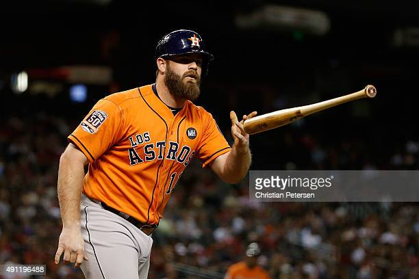 Evan Gattis of the Houston Astros flips his bat after being hit by a pitch during the eighth inning of the MLB game against the Arizona Diamondbacks...