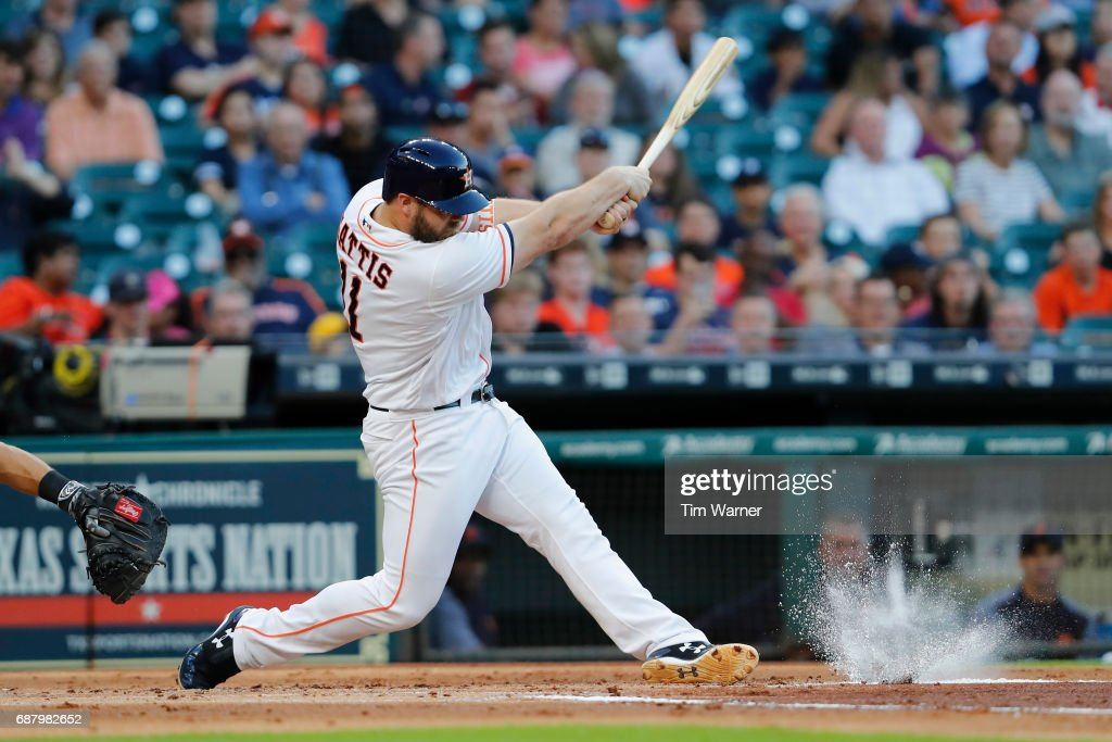 Evan Gattis #11 of the Houston Astros grounds out in the first innig against the Detroit Tigers at Minute Maid Park on May 24, 2017 in Houston, Texas.