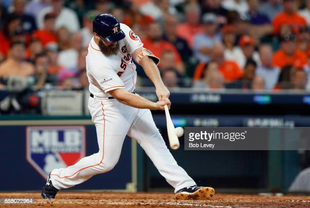 Evan Gattis of the Houston Astros hits a double in the fourth inning against the Boston Red Sox during game one of the American League Division...