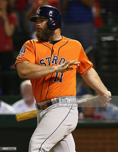 Evan Gattis of the Houston Astros hits a rbi single in the fourth inning against the Texas Rangers at Globe Life Park in Arlington on September 15...