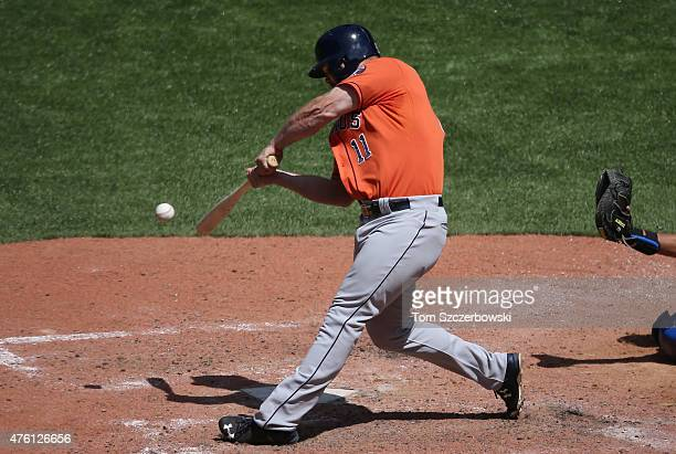 Evan Gattis of the Houston Astros hits a single in the seventh inning during MLB game action against the Toronto Blue Jays on June 6 2015 at Rogers...