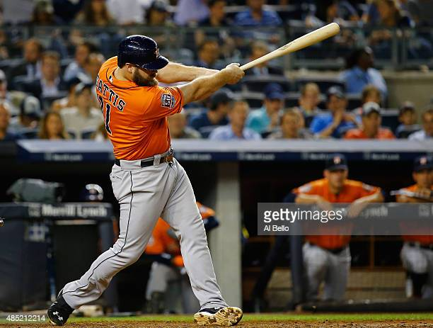 Evan Gattis of the Houston Astros hits a two run home run against the New York Yankees during their game at Yankee Stadium on August 25 2015 in New...