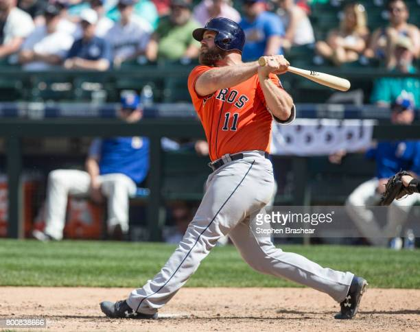 Evan Gattis of the Houston Astros hits a tworun home run off of relief pitcher James Pazos of the Seattle Mariners that scored Carlos Correa of the...