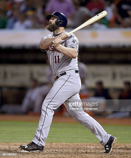 Evan Gattis of the Houston Astros hits a tworun homer against the Oakland Athletics in the top of the fifth inning at Oco Coliseum on September 9...