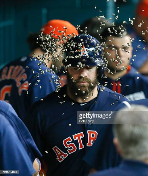 Evan Gattis of the Houston Astros receives a face full of sunflower seeds after hitting a home run in the sixth inning against the Oakland Athletics...