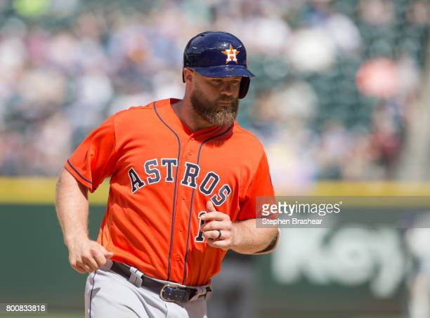 Evan Gattis of the Houston Astros rounds the bases after hitting a tworun home run off relief pitcher James Pazos of the Seattle Mariners that scored...