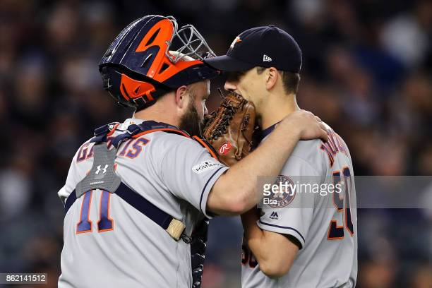 Evan Gattis of the Houston Astros speaks to pitcher Charlie Morton during the fourth inning against the New York Yankees in Game Three of the...
