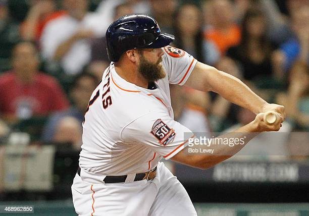 Evan Gattis of the Houston Astros strikes out in the ninth inning as he can't check his swing against the Cleveland Indians at Minute Maid Park on...