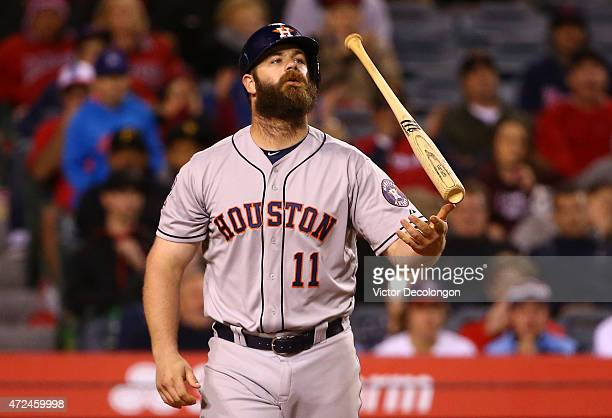 Evan Gattis of the Houston Astros tosses his bat after striking out in the eighth inning during the MLB game against the Los Angeles Angels of...