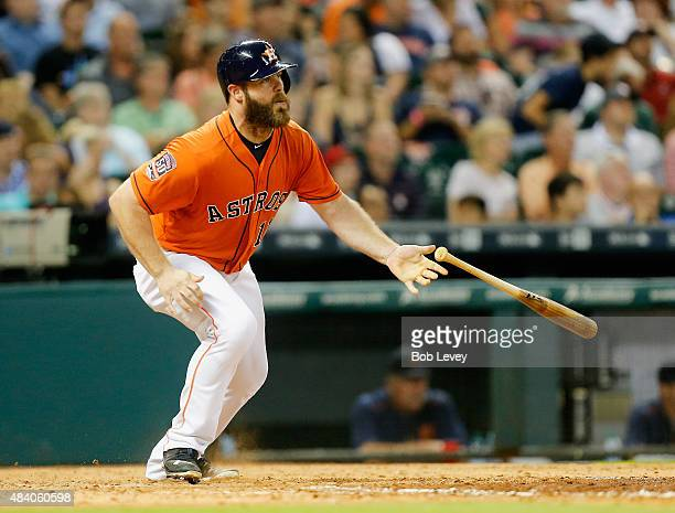 Evan Gattis of the Houston Astros triples in the sixth inning against the Detroit Tigers at Minute Maid Park on August 14 2015 in Houston Texas
