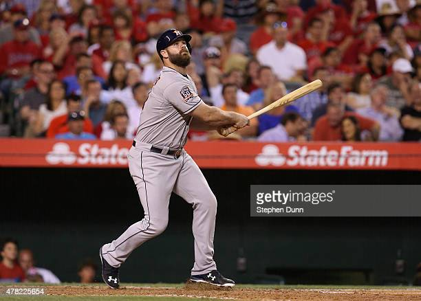 Evan Gattis of the Houston Astros watches his sacrifice fly to bring in George Springer with a run in the fourth inning against the Los Angeles...