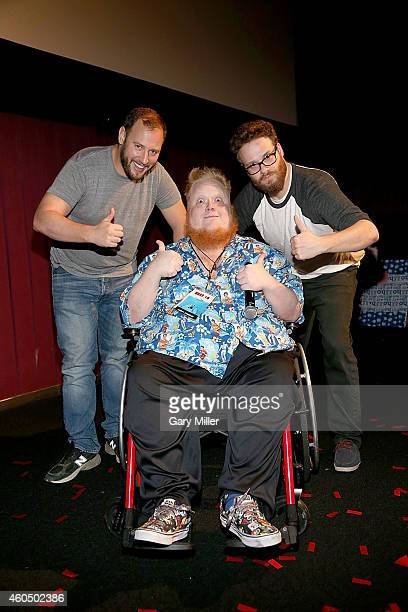 Evan Goldberg Harry Knowles and Seth Rogen pose after a screening of the new film The Interview during Harry Knowles and Ain't It Cool New's...