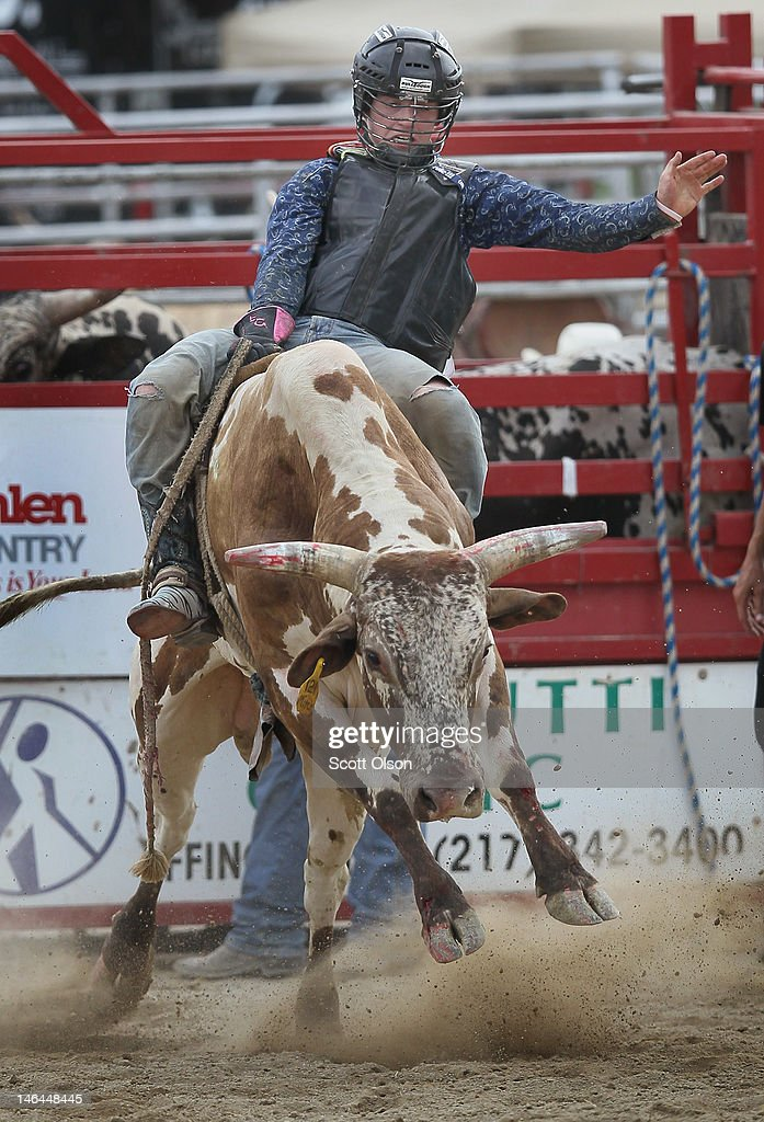 Evan Golliday competes in the bull riding competition at the Illinois High School Rodeo Association State Finals on June 16, 2012 in Altamont, Illinois. Winners in the competition will go on to compete in the high school national championships July 15-21 in Rock Springs, Wyoming.