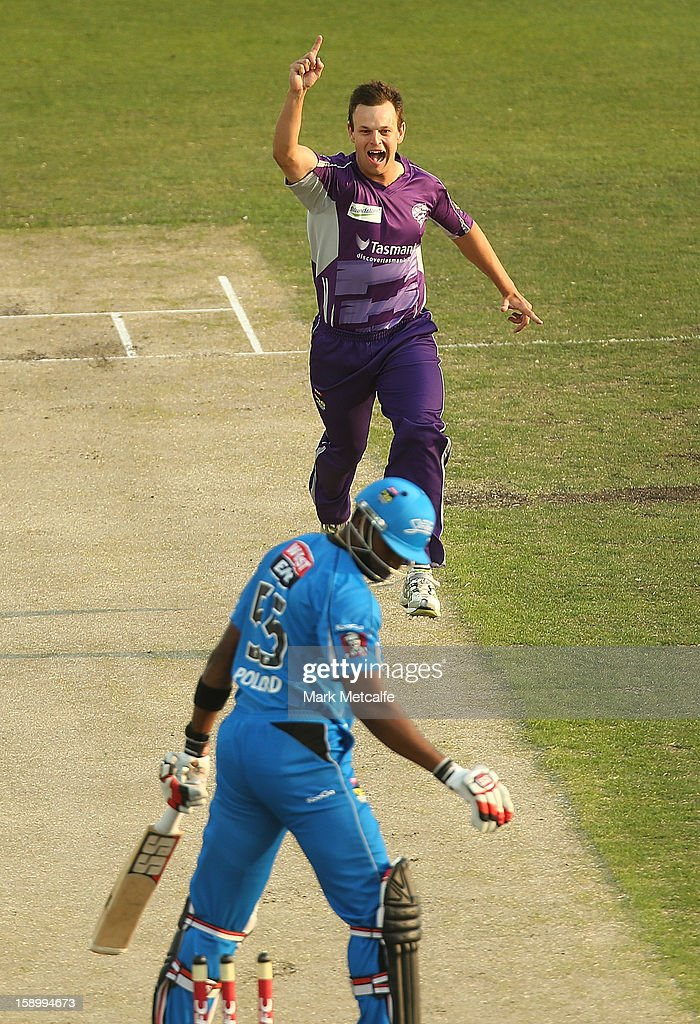 Evan Gulbis of the Hurricanes celebrates the wicket of <a gi-track='captionPersonalityLinkClicked' href=/galleries/search?phrase=Kieron+Pollard&family=editorial&specificpeople=4233862 ng-click='$event.stopPropagation()'>Kieron Pollard</a> of the Strikers during the Big Bash League match between the Hobart Hurricanes and the Adelaide Strikers at Blundstone Arena on January 5, 2013 in Hobart, Australia.