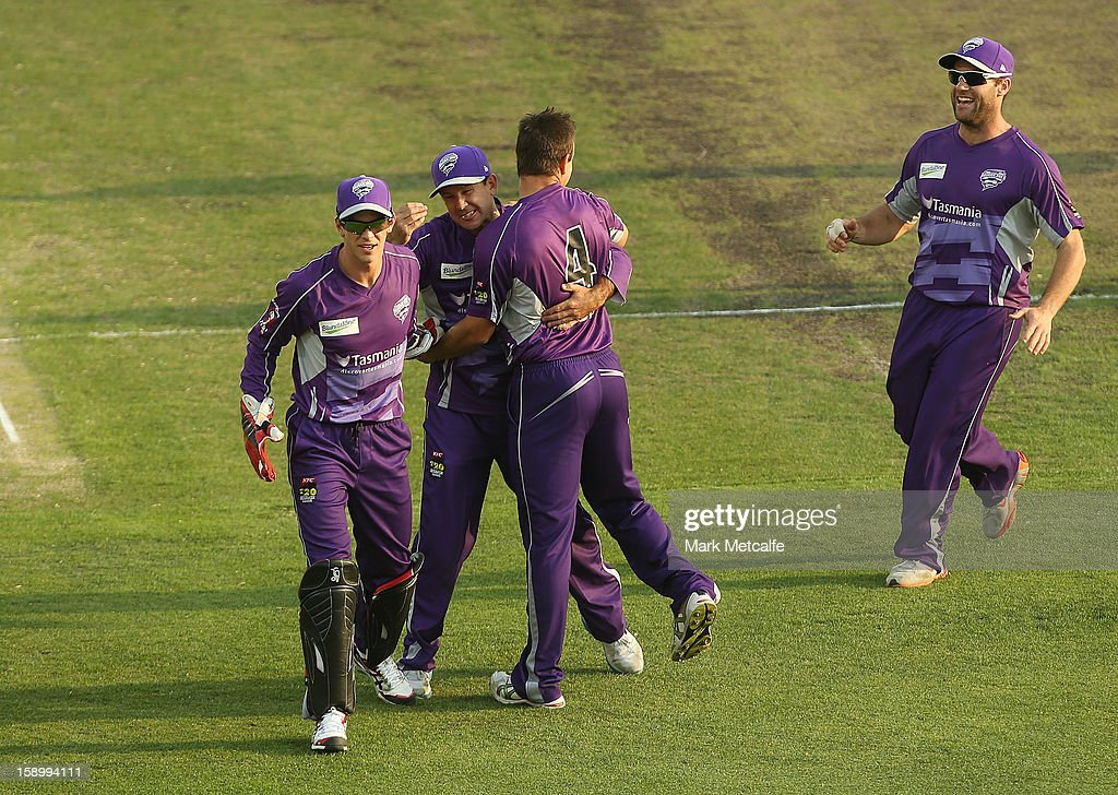 Evan Gulbis of the Hurricanes celebrates with teammate Ricky Ponting after taking the wicket of Kieron Pollard of the Strikers during the Big Bash League match between the Hobart Hurricanes and the Adelaide Strikers at Blundstone Arena on January 5, 2013 in Hobart, Australia.