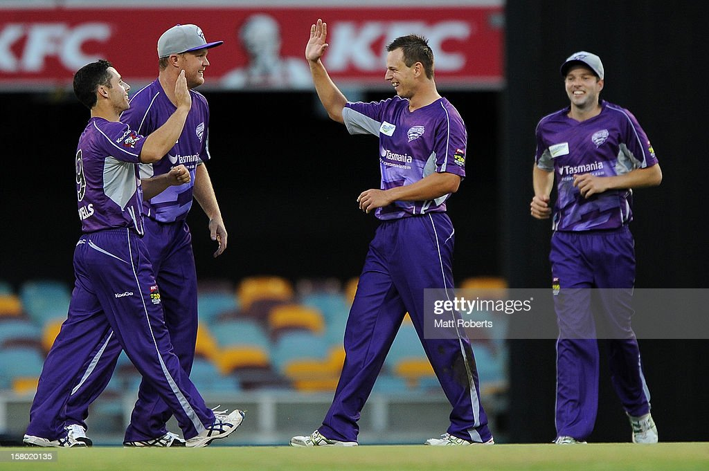 Evan Gulbis (C) of the Hurrucanes celebrates with team mates during the Big Bash League match between the Brisbane Heat and the Hobart Hurricanes at The Gabba on December 9, 2012 in Brisbane, Australia.