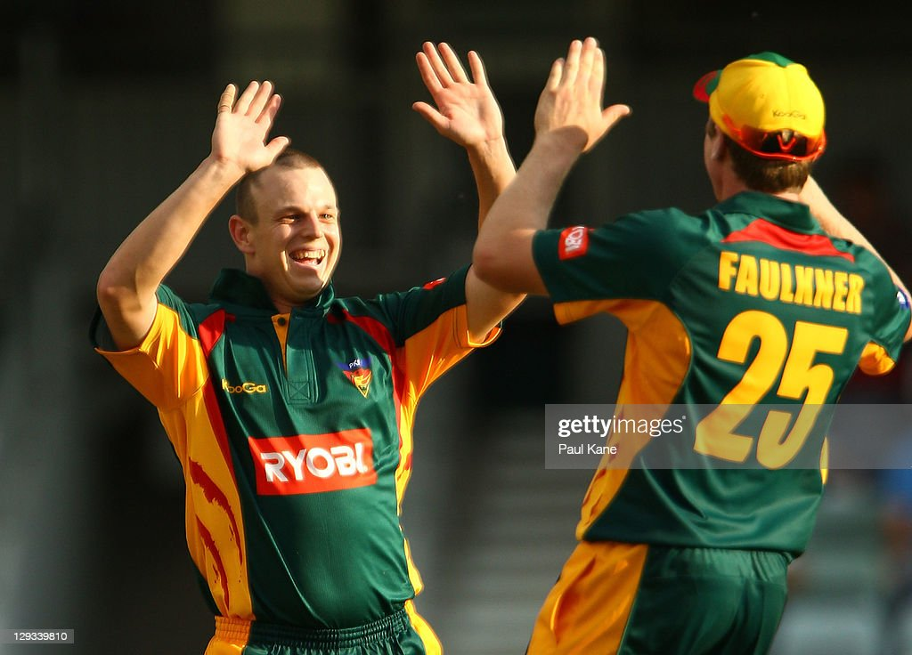 Evan Gulbis of the Tigers celebrates with James Faulkner after dismissing Nathan Rimmington of the Warriors during the Ryobi One-Day Cup match between the West Australian Warriors and the Tasmanian Tigers at the WACA on October 16, 2011 in Perth, Australia.