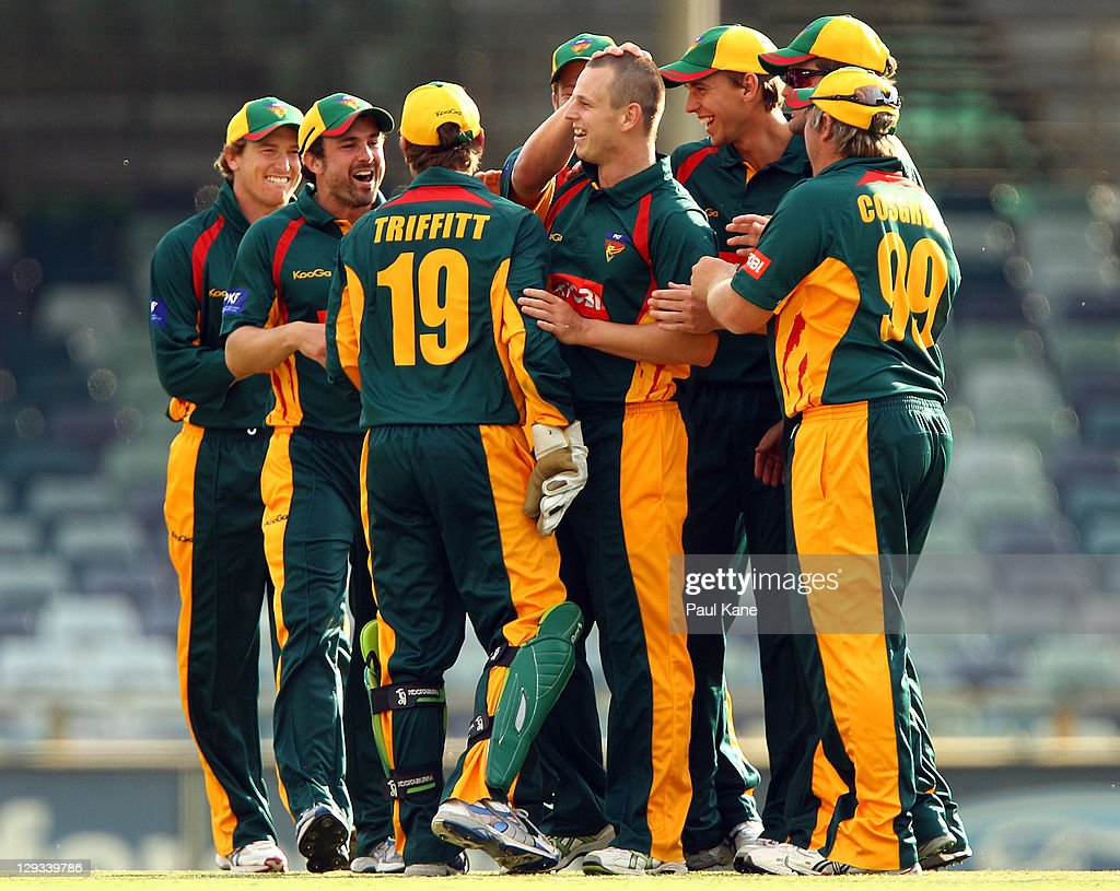 Evan Gulbis of the Tigers celebrates with team mates after dismissing Luke Ronchi of the Warriors during the Ryobi One-Day Cup match between the West Australian Warriors and the Tasmanian Tigers at the WACA on October 16, 2011 in Perth, Australia.