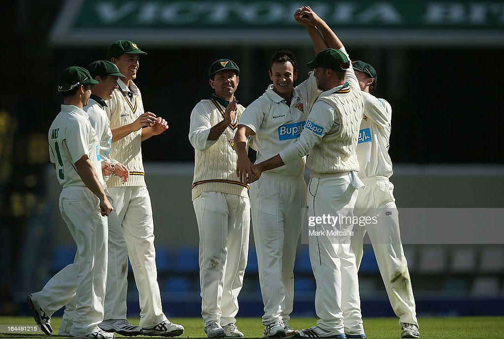 Evan Gulbis of the Tigers celebrates with teammates after taking the wicket of Nathan Reardon of the Bulls during day three of the Sheffield Shield final between the Tasmania Tigers and the Queensland Bulls at Blundstone Arena on March 24, 2013 in Hobart, Australia.