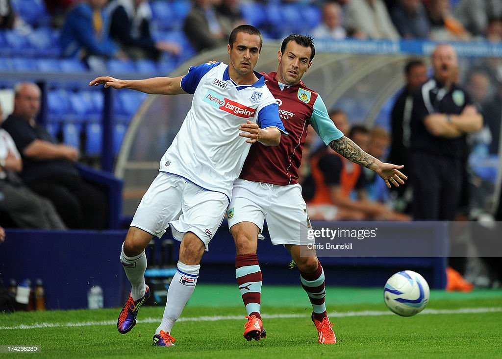 Evan Horwood (L) of Tranmere Rovers in action with Ross Wallace of Burnley during the pre season friendly match between Tranmere Rovers and Burnley at Prenton Park on July 23, 2013 in Birkenhead, England.