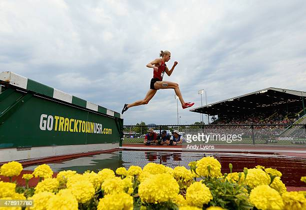 Evan Jager clears the water barrier on the way to victory in the Mens 3000 Meter Steeplechase during day four of the 2015 USA Outdoor Track Field...