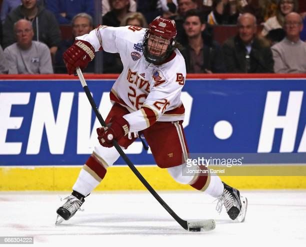 Evan Janssen of the Denver Pioneers shoots against the MinnesotaDuluth Bulldogs during the 2017 NCAA Division I Men's Ice Hockey Championship game at...