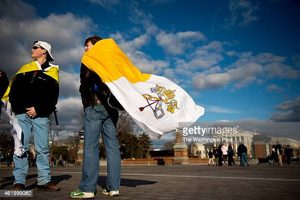 Evan Keimig of Houston Texas left and Brandan Solcher of Sugarland Texas right wear Vatican flags and stand in front of the US Capitol Building...
