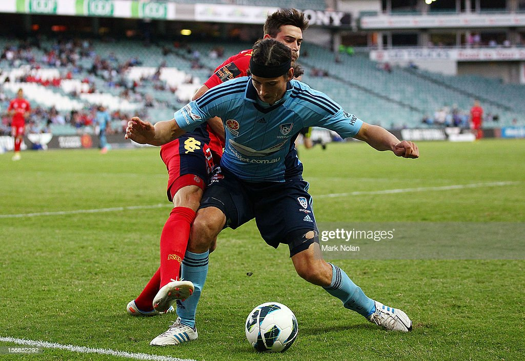 Evan Kostopoulos of Adelaide attempts to tackle Adam Griffiths of Sydney during the round eight A-League match between Sydney FC and Adelaide United at Allianz Stadium on November 23, 2012 in Sydney, Australia.