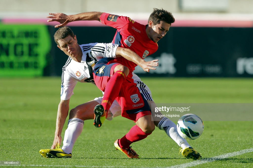 Evan Kostopoulos of Adelaide is tackled by Tony Lochhead of the Phoenix during the round 22 A-League match between the Wellington Phoenix and Adelaide United at Westpac Stadium on February 24, 2013 in Wellington, New Zealand.