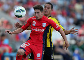 Evan Kostopoulos of Adelaide under pressure from Leo Bertos during the round 11 ALeague match between Adelaide United and the Wellington Phoenix at...