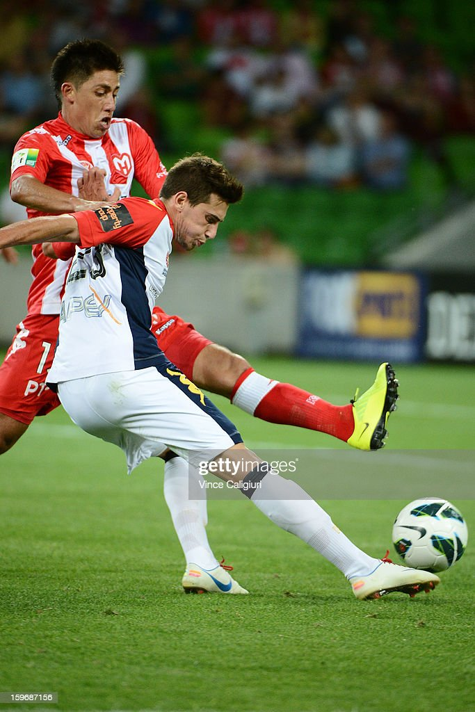 Evan Kostopoulos of United looks to pass the ball past Jonathon Germano of the Heart during the round seventeen A-League match between Melbourne Heart and Adelaide United at AAMI Park on January 18, 2013 in Melbourne, Australia.