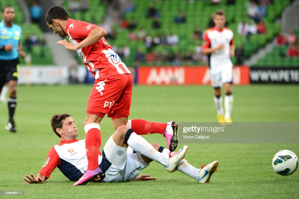 Evan Kostopoulos of United tackles Aziz Behich of the Heart during the round seventeen A-League match between Melbourne Heart and Adelaide United at AAMI Park on January 18, 2013 in Melbourne, Australia.